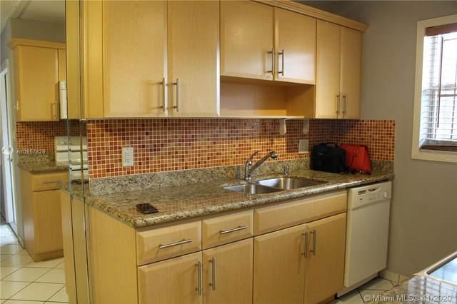 421 NE 1st St #205, Hallandale Beach, FL 33009 (MLS #A10957829) :: Berkshire Hathaway HomeServices EWM Realty