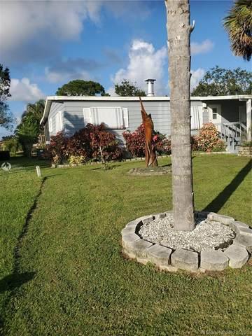 231 SE Paradise Pl, Stuart, FL 34997 (MLS #A10959594) :: The Teri Arbogast Team at Keller Williams Partners SW