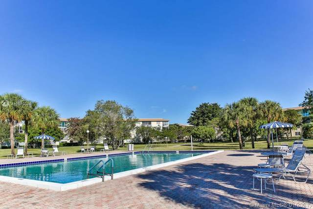 1604 Abaco Dr C2, Coconut Creek, FL 33066 (MLS #A10985024) :: Green Realty Properties