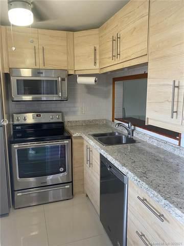 9091 Lime Bay Blvd #202, Tamarac, FL 33321 (MLS #A10991899) :: Search Broward Real Estate Team