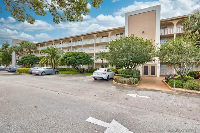2102 Lucaya Bnd E1, Coconut Creek, FL 33066 (MLS #A10994776) :: Search Broward Real Estate Team