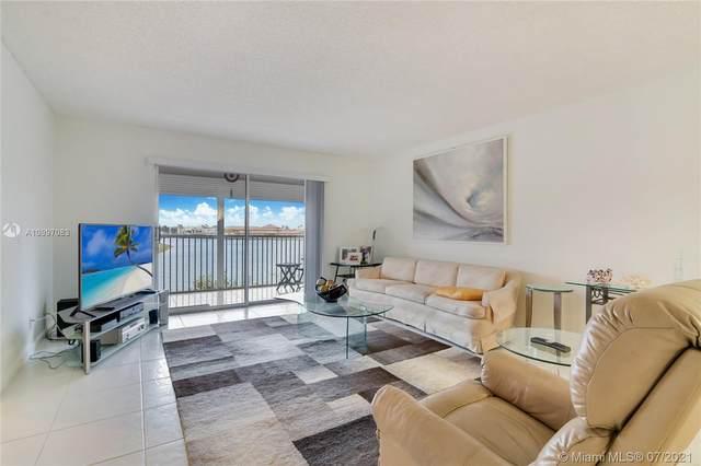12950 SW 13th St #404, Pembroke Pines, FL 33027 (MLS #A10997083) :: Prestige Realty Group