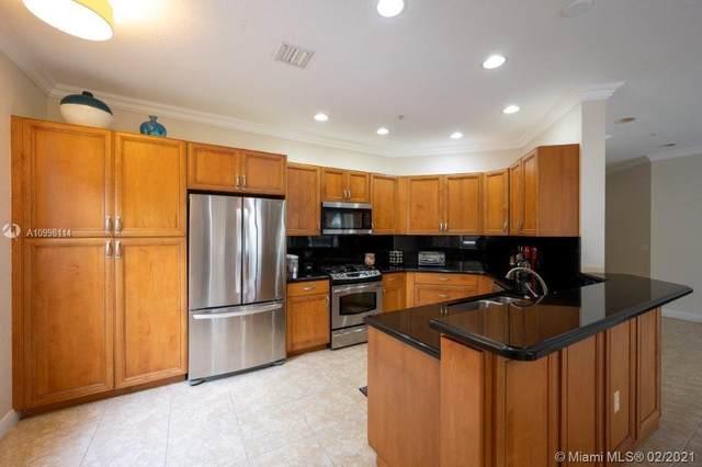2901 NW 126th Ave 2-323, Sunrise, FL 33323 (MLS #A10998114) :: Berkshire Hathaway HomeServices EWM Realty