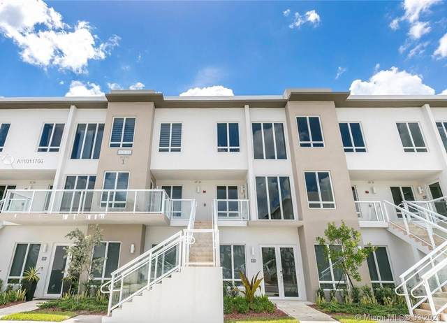 6415 NW 102nd Path #102, Doral, FL 33178 (MLS #A11011766) :: The Howland Group