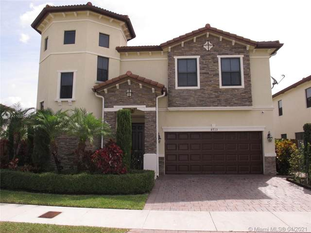 8713 NW 99th Ave, Doral, FL 33178 (MLS #A11025492) :: Albert Garcia Team