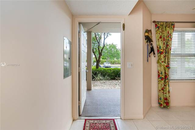700 SW 137th Ave 110H, Pembroke Pines, FL 33027 (MLS #A11027314) :: The Teri Arbogast Team at Keller Williams Partners SW