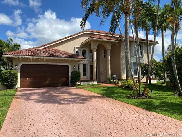 9955 NW 49th Pl, Coral Springs, FL 33076 (MLS #A11049916) :: Team Citron