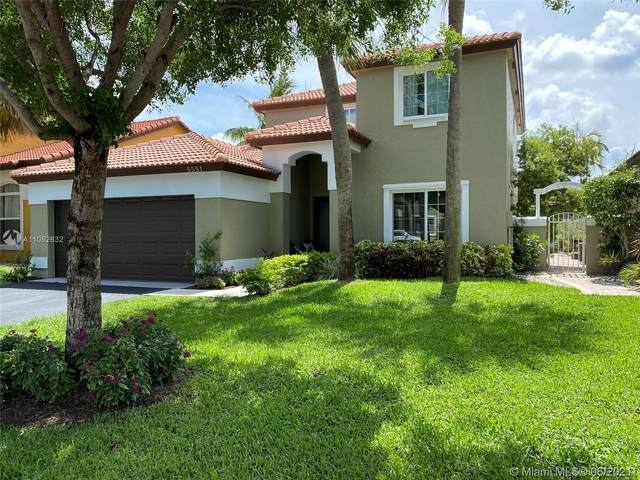 5551 NW 50th Ave, Coconut Creek, FL 33073 (MLS #A11052632) :: The Riley Smith Group