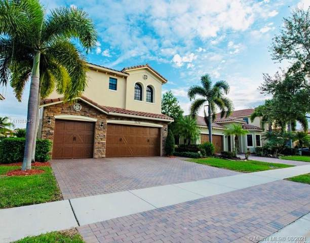7534 NW 113th Ave, Parkland, FL 33076 (MLS #A11084045) :: Re/Max PowerPro Realty