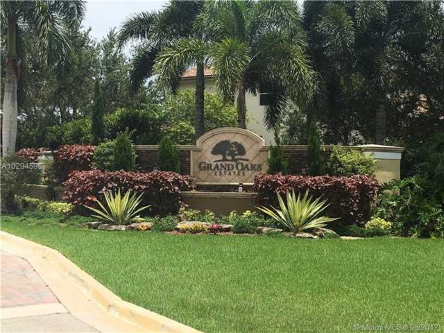 12882 Grand Oaks Dr, Davie, FL 33330 (MLS #A10294596) :: The Teri Arbogast Team at Keller Williams Partners SW