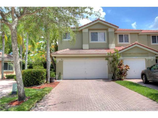 12591 NW 57th Pl, Coral Springs, FL 33076 (MLS #A10314568) :: Castelli Real Estate Services