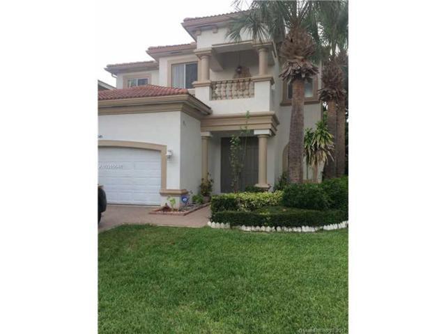 1045 Grove Park Cir, Boynton Beach, FL 33436 (MLS #A10316648) :: The Teri Arbogast Team at Keller Williams Partners SW