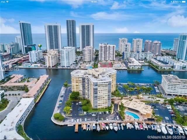 100 Golden Isles Drive #1414, Hallandale, FL 33009 (MLS #A10676407) :: Berkshire Hathaway HomeServices EWM Realty
