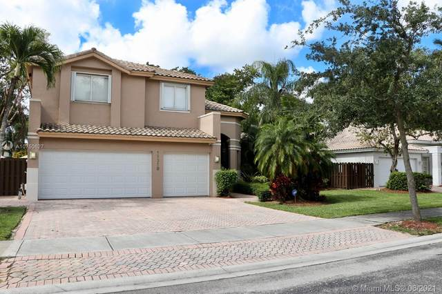 11310 NW 61st St, Doral, FL 33178 (MLS #A10750627) :: The Pearl Realty Group