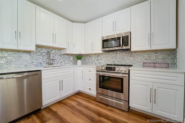 3499 Oaks Way #202, Pompano Beach, FL 33069 (MLS #A10818771) :: Grove Properties