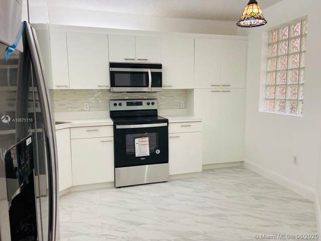 4121 Coral Tree Cir #136, Coconut Creek, FL 33073 (MLS #A10875118) :: Berkshire Hathaway HomeServices EWM Realty