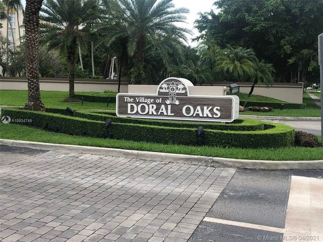 9755 NW 52nd St #115, Doral, FL 33178 (MLS #A10934745) :: Prestige Realty Group