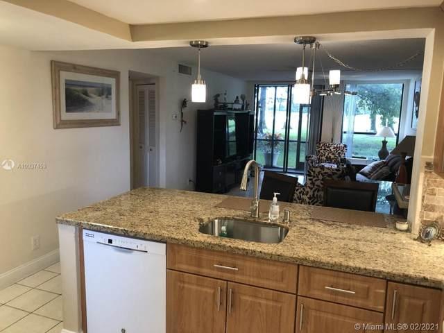 7750 W Mcnab Rd #114, Tamarac, FL 33321 (#A10937453) :: Posh Properties