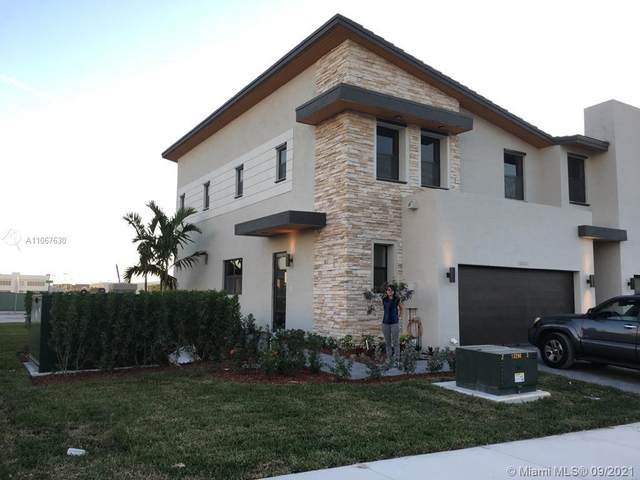 10404 NW 78th Ter #10404, Doral, FL 33178 (MLS #A11067630) :: Castelli Real Estate Services