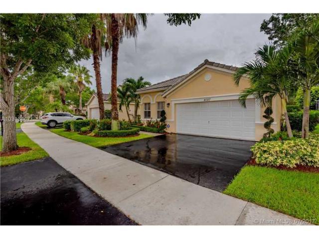 4027 Palm Pl, Weston, FL 33331 (MLS #A10313447) :: Castelli Real Estate Services