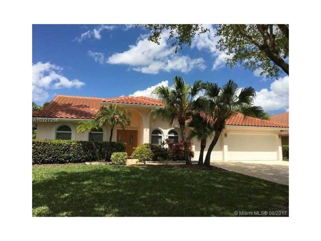 6051 NW 61st St, Parkland, FL 33067 (MLS #A10327256) :: The Chenore Real Estate Group