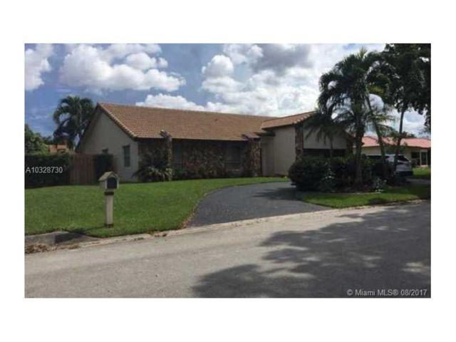 411 NW 101st Ave, Coral Springs, FL 33071 (MLS #A10328730) :: The Teri Arbogast Team at Keller Williams Partners SW