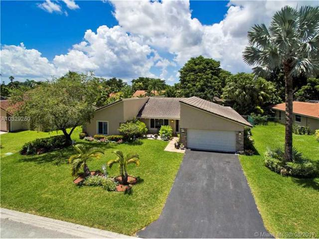 1920 NW 107th Ter, Coral Springs, FL 33071 (MLS #A10329250) :: The Teri Arbogast Team at Keller Williams Partners SW