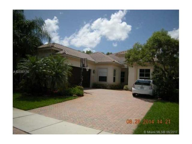 7467 NW 114th Ter, Parkland, FL 33076 (MLS #A10330176) :: The Chenore Real Estate Group