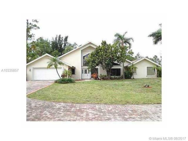 6113 NW 66TH WAY, Parkland, FL 33067 (MLS #A10335857) :: Stanley Rosen Group