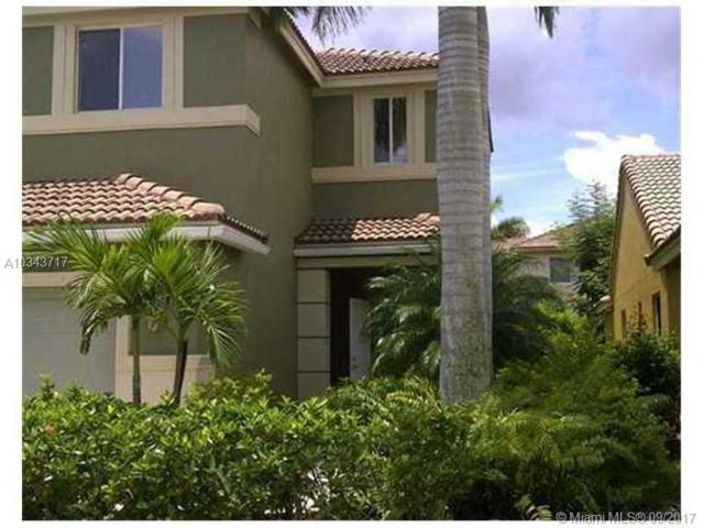 1052 Golden Cane Dr, Weston, FL 33327 (MLS #A10343717) :: Green Realty Properties