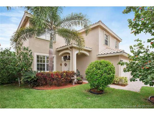 5418 NW 121st Ave, Coral Springs, FL 33076 (MLS #A10316404) :: Castelli Real Estate Services