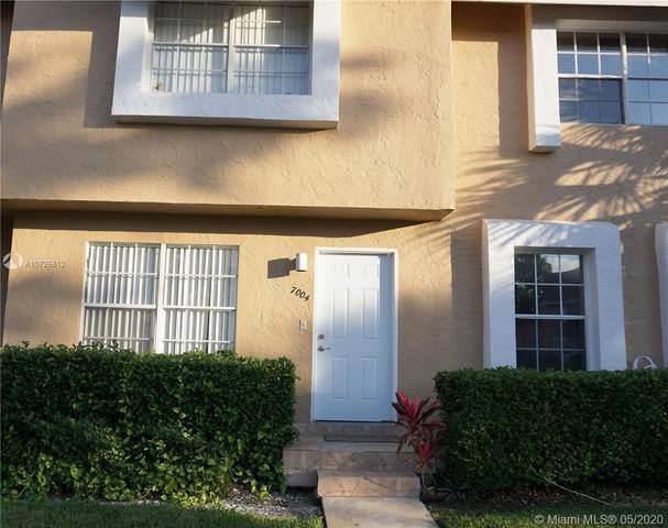 7004 Woodmont Ave, Tamarac, FL 33321 (MLS #A10726812) :: Berkshire Hathaway HomeServices EWM Realty