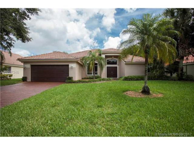 6825 NW 74th Ct, Parkland, FL 33067 (MLS #A10297346) :: The Chenore Real Estate Group