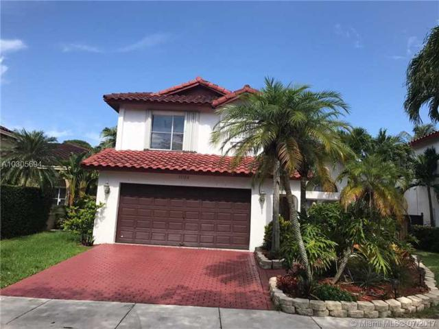11126 SW 148th Pl, Miami, FL 33196 (MLS #A10305694) :: The Teri Arbogast Team at Keller Williams Partners SW