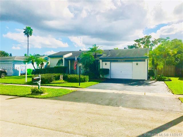 11830 NW 37th St, Sunrise, FL 33323 (MLS #A10376161) :: Stanley Rosen Group