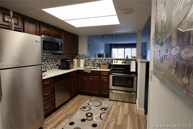 3143 Riverside Dr B-102, Coral Springs, FL 33065 (MLS #A10403567) :: Jamie Seneca & Associates Real Estate Team