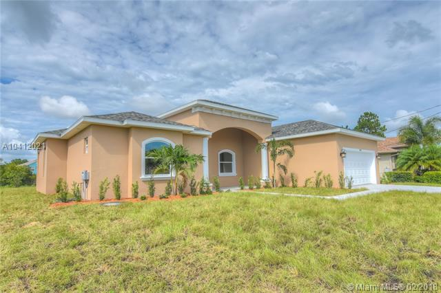 5784 NW Wesley Rd, Port St. Lucie, FL 34986 (MLS #A10412021) :: The Teri Arbogast Team at Keller Williams Partners SW