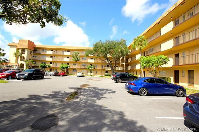 6301 N Falls Cir Dr #406, Lauderhill, FL 33319 (MLS #A10412943) :: The Teri Arbogast Team at Keller Williams Partners SW