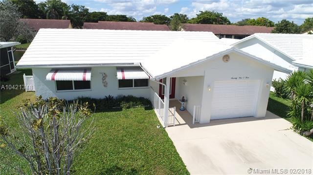 7103 NW 73rd Ave, Tamarac, FL 33321 (MLS #A10421348) :: The Teri Arbogast Team at Keller Williams Partners SW