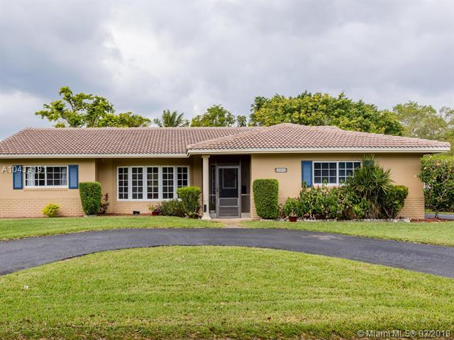 3900 NW Coral Hills Drive, Coral Springs, FL 33065 (MLS #A10433191) :: The Teri Arbogast Team at Keller Williams Partners SW