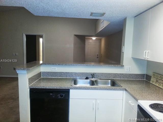5055 Wiles Rd #307, Coconut Creek, FL 33073 (MLS #A10434129) :: Stanley Rosen Group