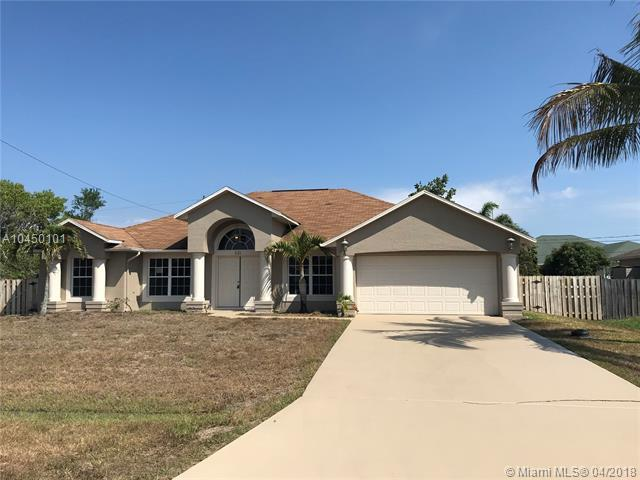 521 SW Lawler Ave, Port St. Lucie, FL 34953 (MLS #A10450101) :: The Teri Arbogast Team at Keller Williams Partners SW