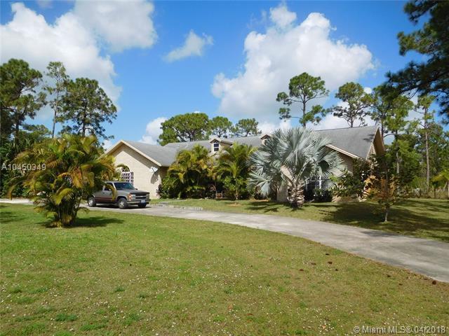 9026 Hall Blvd, Loxahatchee, FL 33470 (MLS #A10450349) :: Stanley Rosen Group