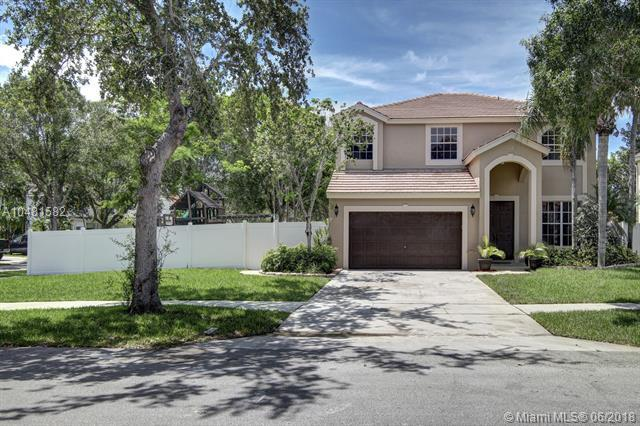 5821 NW 62nd St, Parkland, FL 33067 (MLS #A10481582) :: Green Realty Properties