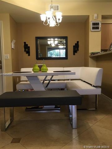 8070 N Nob Hill Rd #104, Tamarac, FL 33321 (MLS #A10484893) :: Prestige Realty Group