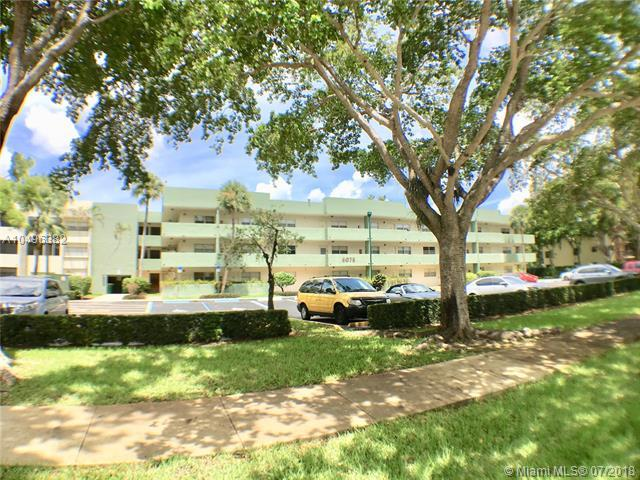 6075 N Sabal Palm Blvd #205, Tamarac, FL 33319 (MLS #A10496382) :: The Teri Arbogast Team at Keller Williams Partners SW