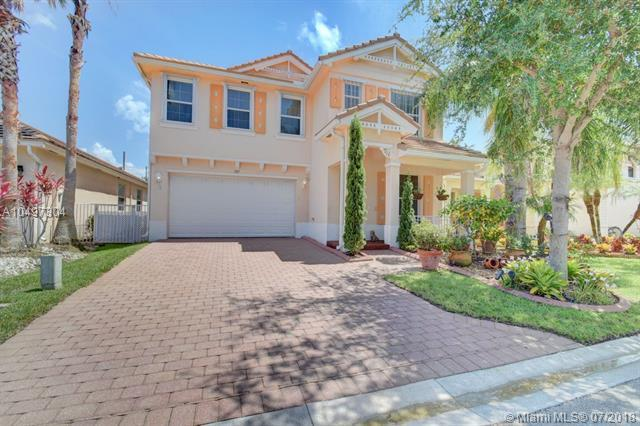 587 Belle Grove Ln, Royal Palm Beach, FL 33411 (MLS #A10497304) :: The Teri Arbogast Team at Keller Williams Partners SW