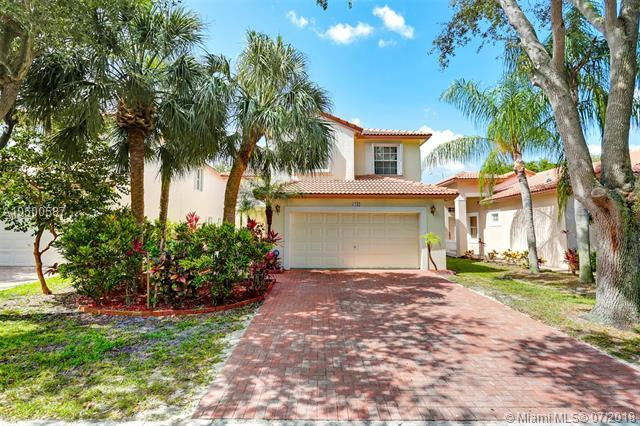 6242 NW 38th Dr, Coral Springs, FL 33067 (MLS #A10500587) :: The Teri Arbogast Team at Keller Williams Partners SW