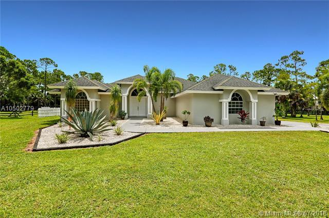 2558 Palm Deer Dr, Loxahatchee, FL 33470 (MLS #A10502779) :: Green Realty Properties