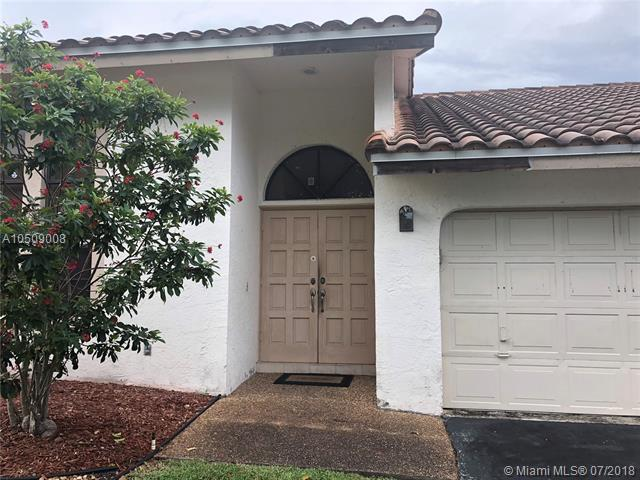 5656 NW 64th Ln, Coral Springs, FL 33067 (MLS #A10509008) :: Prestige Realty Group
